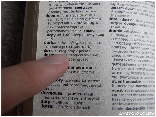 Photo of a finger thumbing through a dictionary